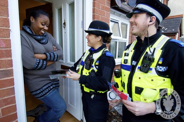 citizen talking with police on her doorstep